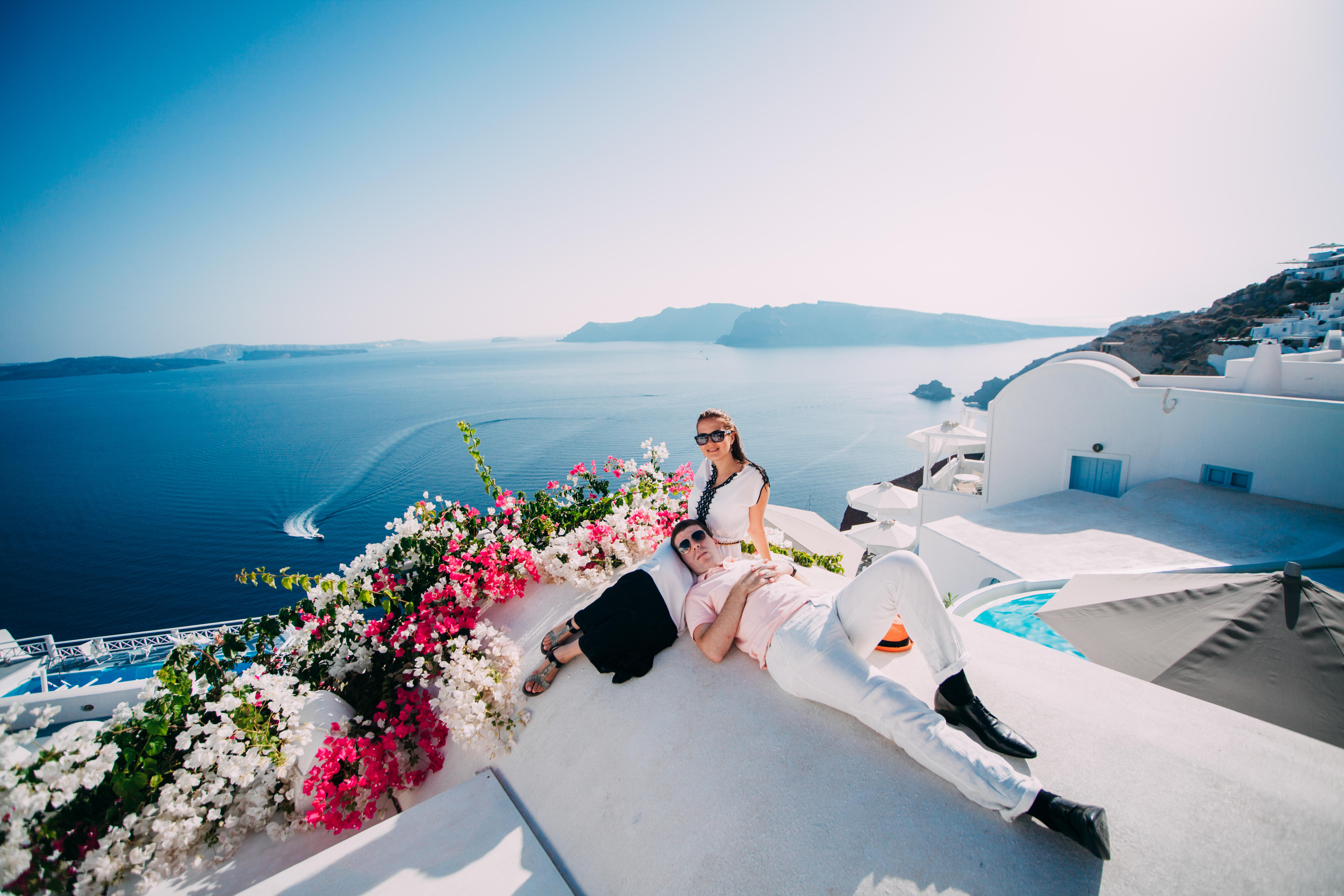 Young Couple Embracing On The Beach In Santorini Greece