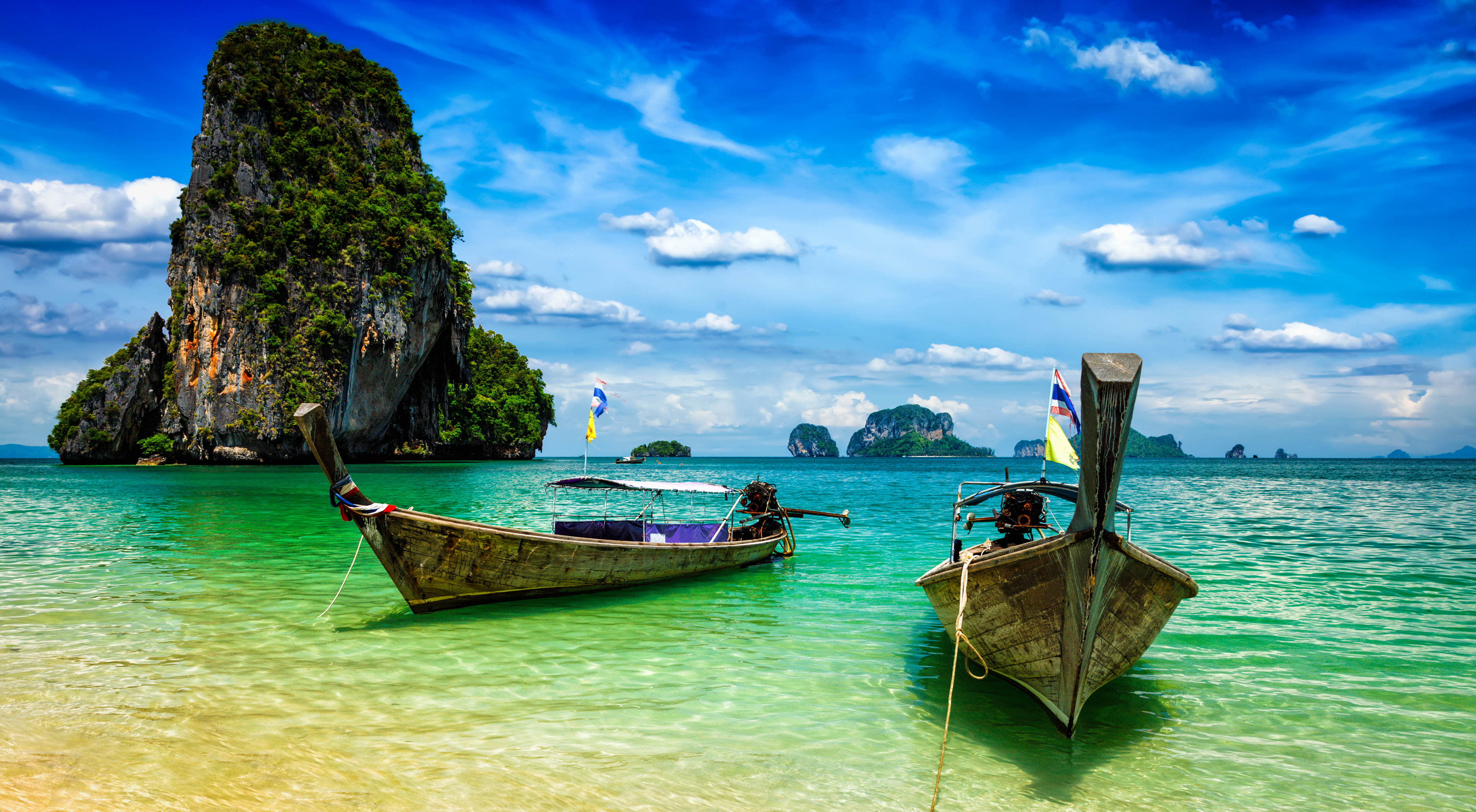 Long Tail Boats On Beach Thailand