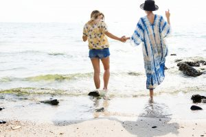 best LGBTA wedding tips two ladies on beach