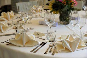 Destination wedding etiquette table with invitations