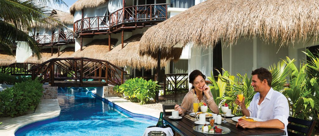 romantic travel hotspot el dorado casitas royale couple at table by casita
