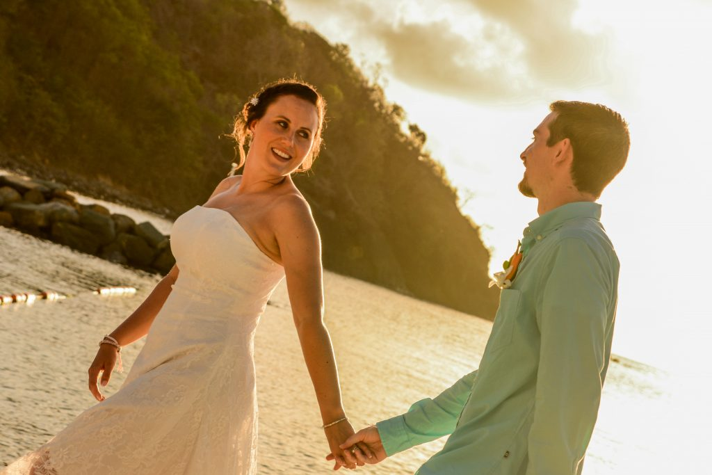 top 10 destination wedding locations couple holding hands on beach