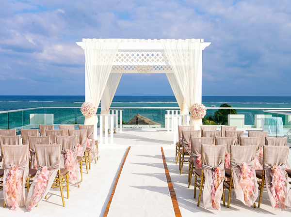 A beautiful backdrop of the ocean makes for the perfect destination wedding scene. #destinationwedding #isaidyes #epicwedding #beachwedding #girlswhotravel #seetheworld