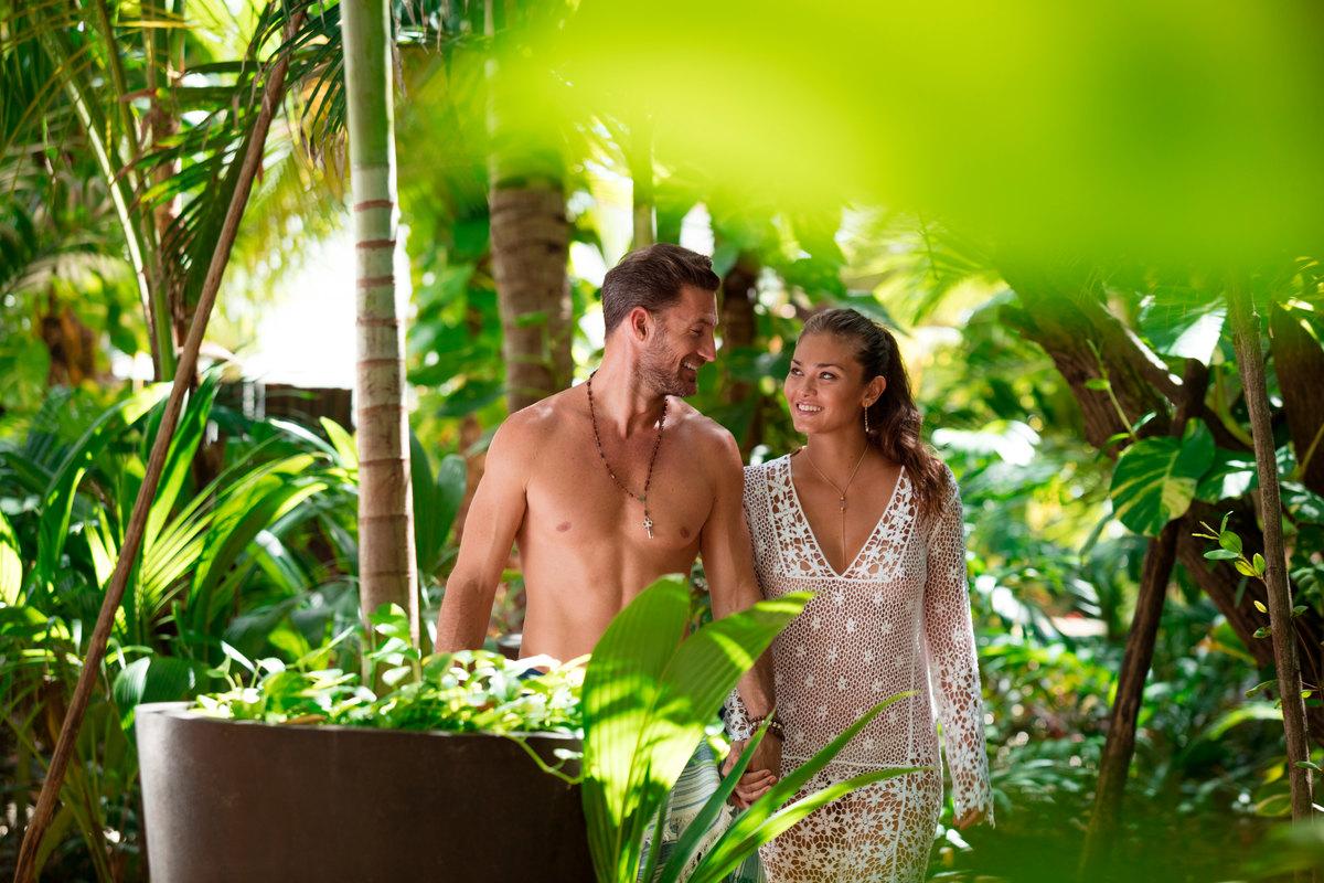 couple walking at clothing optional resort